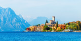 Fototapety Ancient tower and colorful houses in malcesine old town