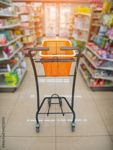 Keuken foto achterwand Boodschappen basket on shopping cart in supermarket