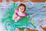 Creative little girl having fun with paint