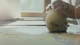 Baker kneading dough. Slow motion