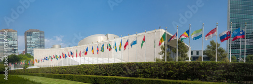 UN United Nations general assembly building with world flags fly - 3:1 aspect ra Poster