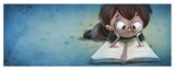 niño con gafas leyendo un libro