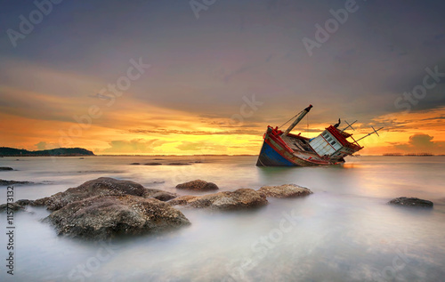Foto op Canvas Foto van de dag ship wrecked at sunset in Chonburi ,Thailand