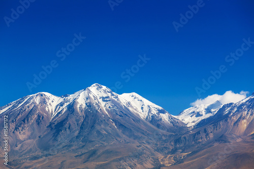 mountain range covered with snow