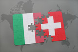 puzzle with the national flag of italy and switzerland on a world map background.