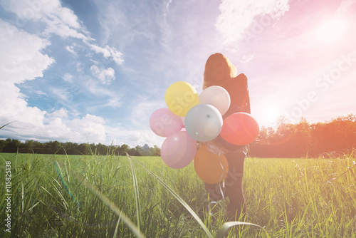 imagination and creativity, girl with multicolored balloons at sunset with copys Poster