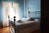 room interior with old metal bed and blue walls - 115830712