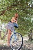 Young woman with retro bicycle in a park