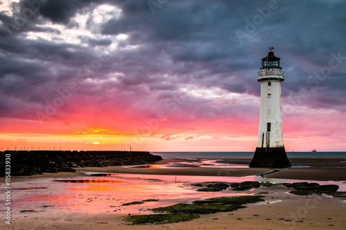 Poster Perch Rock lighthouse at New Brighton near Liverpool at sunset.