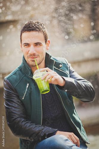 Zdjęcia na płótnie, fototapety, obrazy : Man Enjoying a Smoothie Outside