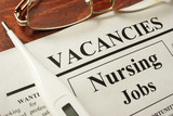 Newspaper with ads nursing jobs vacancy. Occupation concept.