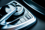 Luxury car interior details. Middle console with gearbox control