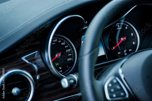 Luxury car interior details. Speedometer, steering wheell Poster