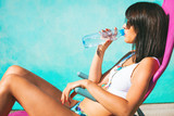woman take sunbath and drink water