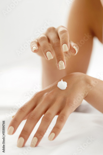 Poster Hand Cream. Close Up Of Woman's Hands Applying Lotion On Skin