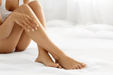 Hair Removal. Close Up Woman Hands Touching Long Legs, Soft Skin - 115884937