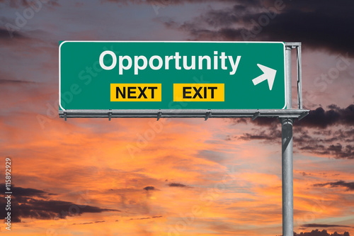 Opportunity Next Exit Freeway Sign with Sunrise Sky