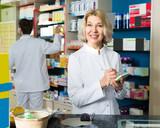 Female pharmacist in drugstore.