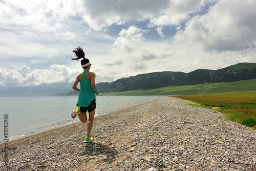 Tuinposter Gymnastiek healthy lifestyle young woman runner running on seaside