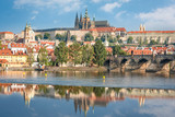 View over river Vltava and Charles bridge to Prague castle with copy space in clear sky