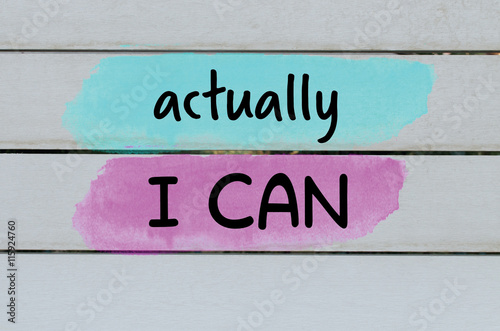 Actually I can motivational message on wooden painted background Photo by Sabinezia