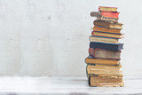 Fototapety stack of books on white wooden background