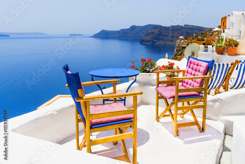 Two chairs with table on a terrace in Santorini, Greece