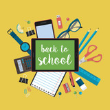Modern back to school background with flat school supplies and d