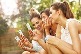 Happy group of friends with smartphones
