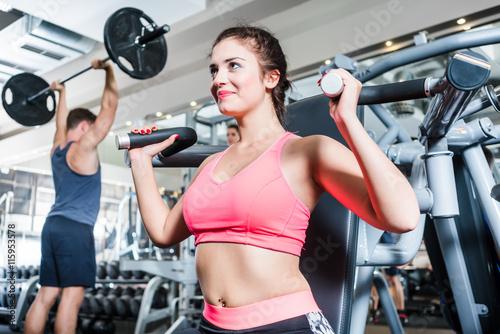 fototapeta na ścianę Woman and man having sport training in fitness gym