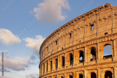 Beautiful sky at sunset with the top of the Colosseum in the frame