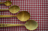 four wooden spoon on the tablecloth
