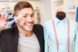 Cheerful male tailor enjoying his job