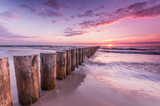 Wooden breakwater - Baltic seascape at sunset, Poland