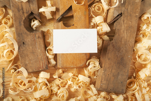 Foto op Plexiglas Trappen Business card on wooden table for carpenter tools with sawdust.