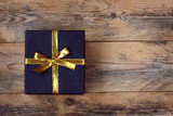 black gift box on wooden table