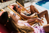 Women relaxing and sunbathing - 116015345