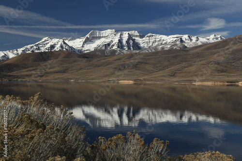 Snow covered mountains reflected in a lake