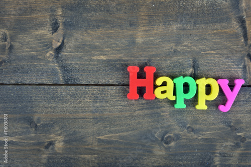 Poster Happy on wooden table