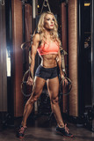 Female doing workouts with trx fitness strips.