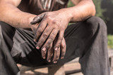 Worker Hands. Charcoal-burners worker man with dirty hands. - 116054322