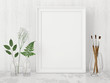 Vertical interior poster mock up with empty frame, artistic brushes and plants in bottles on white wall background. 3D rendering.