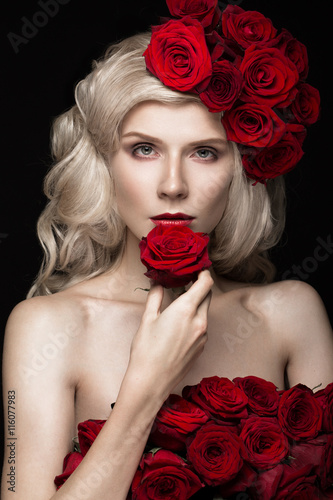 Beautiful blond girl in dress and hat with roses, classic makeup, curls, red lips Poster