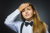 Portrait of offense girl isolated on gray background. Negative human emotion, facial expression. Closeup
