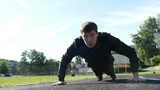 young man push ups on the playground