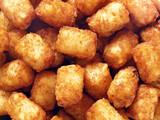 Fototapety rustic golden potato tater tots food background