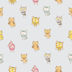 Seamless pattern with various species of cute cartoon colorful owls on  gray  background.  Little funny forest birds. Children's illustration. Vector image.