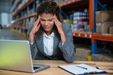Business woman is stressed because of work