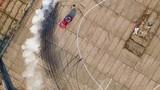 the car does drift on asphalt and burning tires