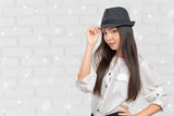 Beautiful young woman wearing summer fedora straw hat posing